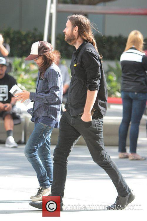 Ellen Page with a male companion arriving at...