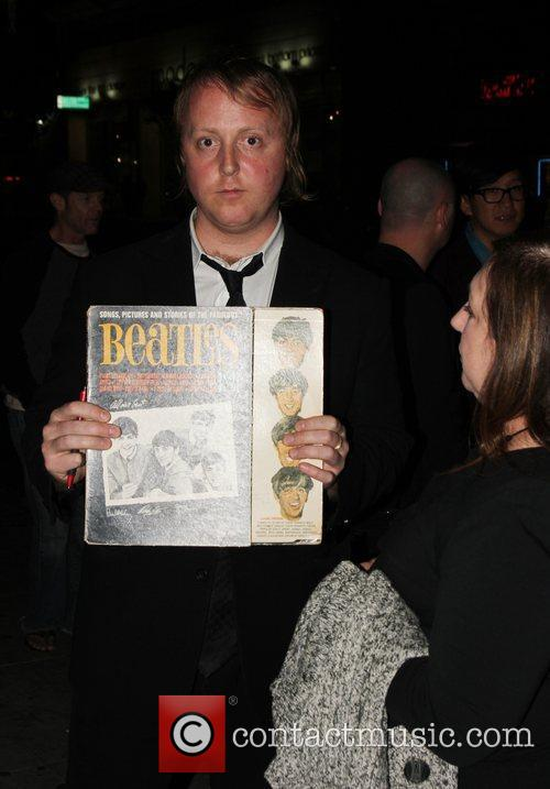 James McCartney signs a The Beatles album for...