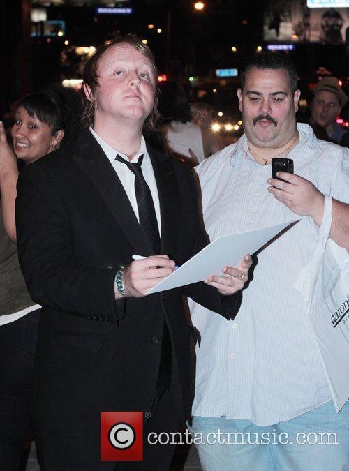 James McCartney signs autographs for fans as he...
