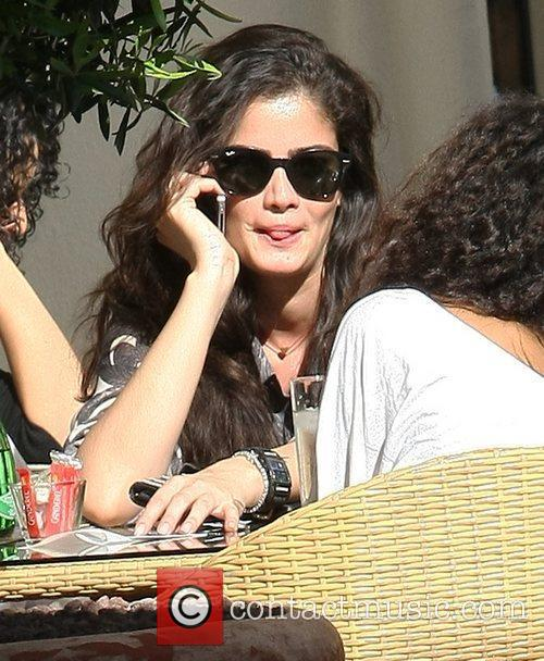 German model Shermine Shahrivar chats on her mobile...