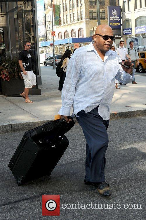 Actor outside his Manhattan hotel with his luggage