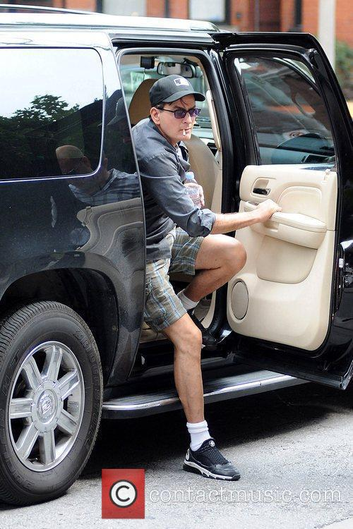 Charlie Sheen  climbs out of his suv...