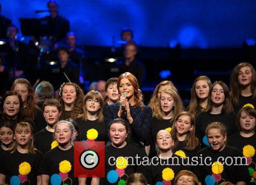 Sophie Evans sings with a choir BBC Children...