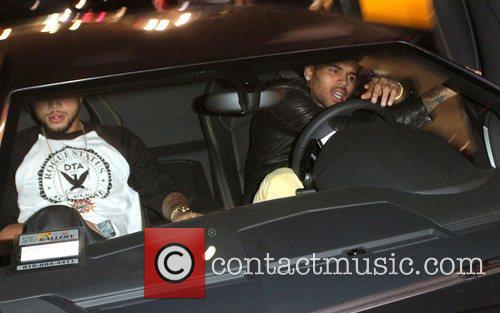 Chris Brown in his Lamborghini car after a...