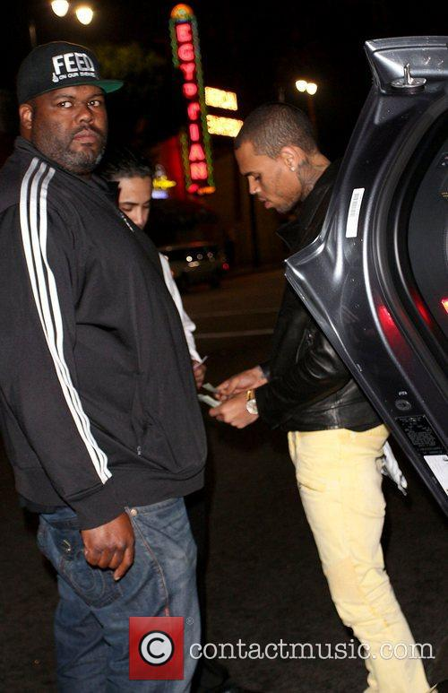 Chris Brown seen paying the valet when he...