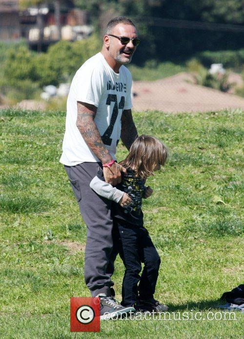 Christian Audigier and his son at a local...