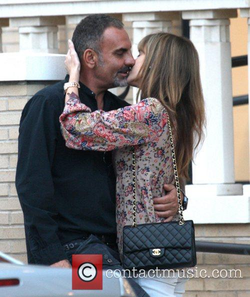 Christian Audigier and Nathalie Sorensen share a romantic...