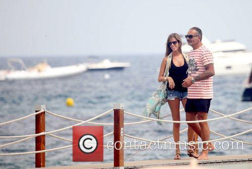 French Designer Christian Audigier and his girlfriend Brazilian...