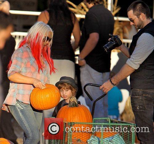 Christina Aguilera, Matthew Rutler taking a photo, and...