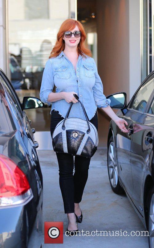 Christina Hendricks  leaving Hugo Boss boutique in...