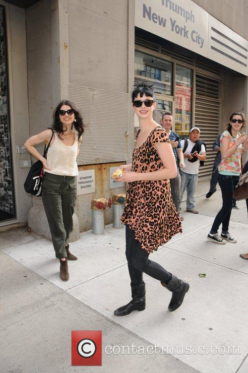 Actress Krysten Ritter seen out and about holding...