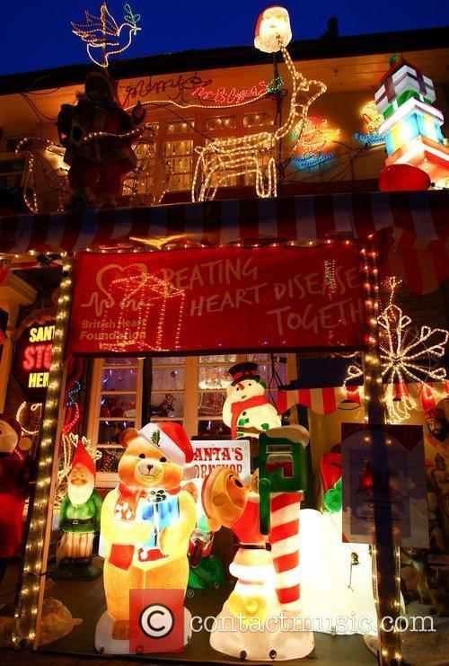 A house displays an excessive amount of exterior christmas for Christmas house music