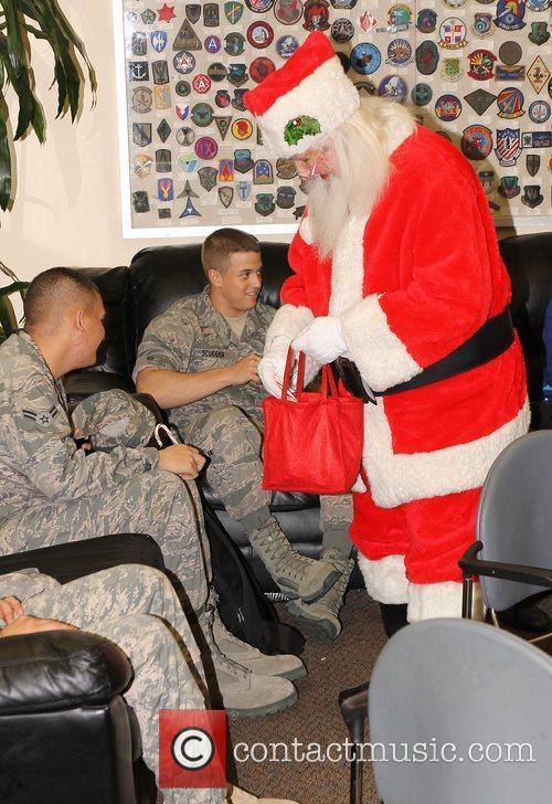 Santa Claus distributing gifts,  at the United...