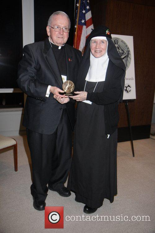 Mother Dolores Hart and Marty Lyons receive her...