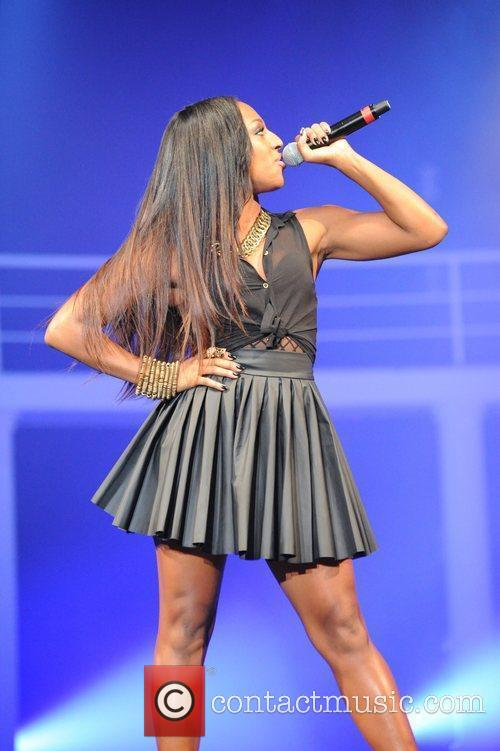 Alexandra Burke performing at the Clothes Show being...