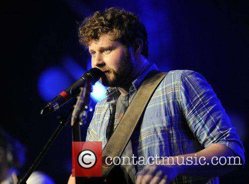 Dan Mangan  performs on stage with The...