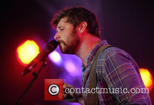 dan mangan performs on stage with the 3797581
