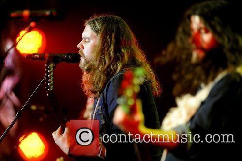 Ewan Currie of The Sheepdog performs on stage...