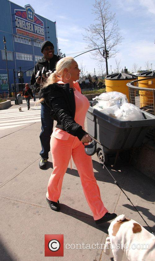 Coco Austin takes her dog Spartacus to the...