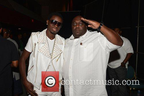 Faizon Love and Comedian Michael Blackson backstage during...