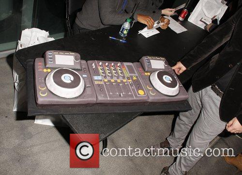 A DJ turntable themed cake is brought out...