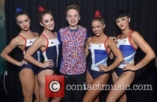 Conor Maynard poses backstage with dancers before performing...