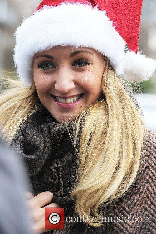 Catherine Tyldsley wearing a Christmas hat outside Granada...