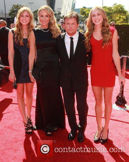 Tracy Pollan, Michael J. Fox with kids Esma...