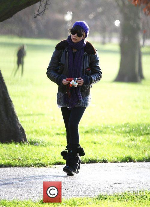 Daisy Lowe walking in the park London, England...