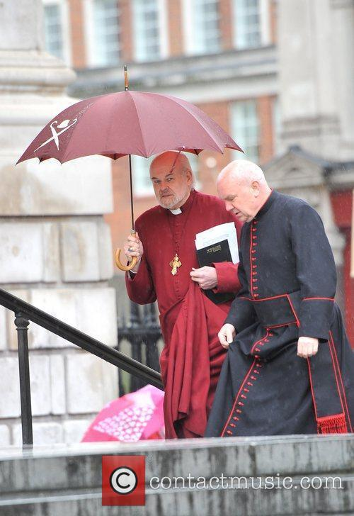 The Bishop of London Richard Chartres (L) His...