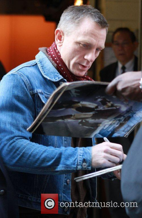 Signs autographs for waiting fans outside the 'LIVE!...