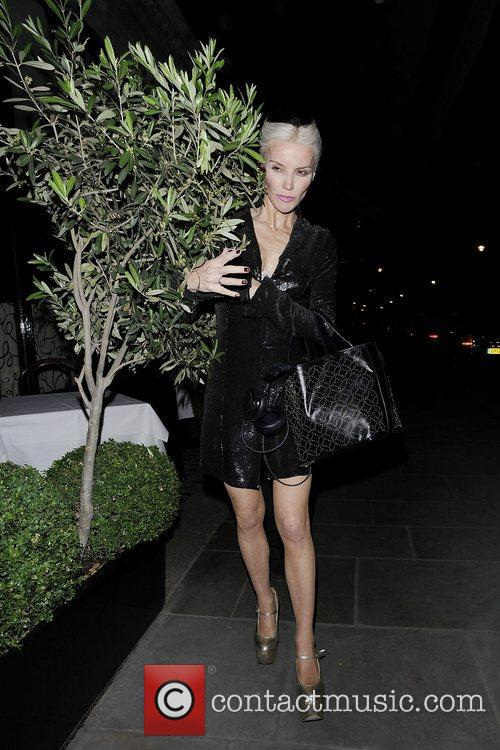 Daphne Guinness out and about wearing gold high...