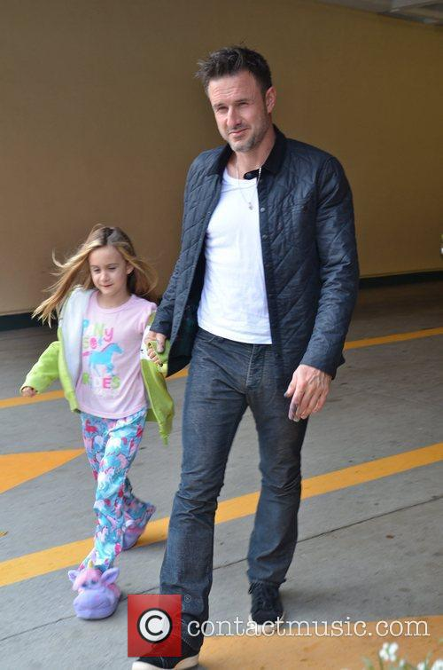 Takes his daughter Coco to doctors in Beverly...