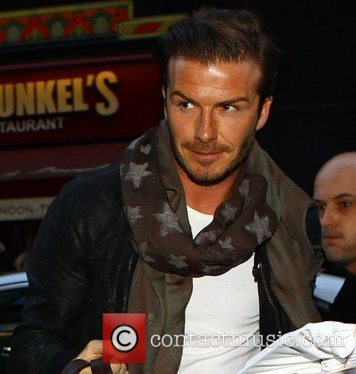 David Beckham arrives at the H&M store in...