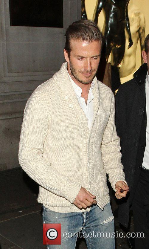 David Beckham  leaving the H&M store in...