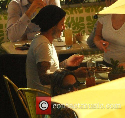 David Beckham  having lunch with his two...