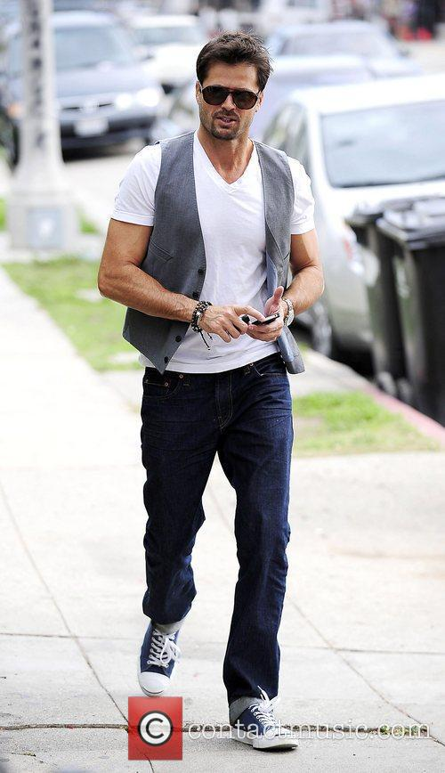 David Charvet wearing a vest while out running...