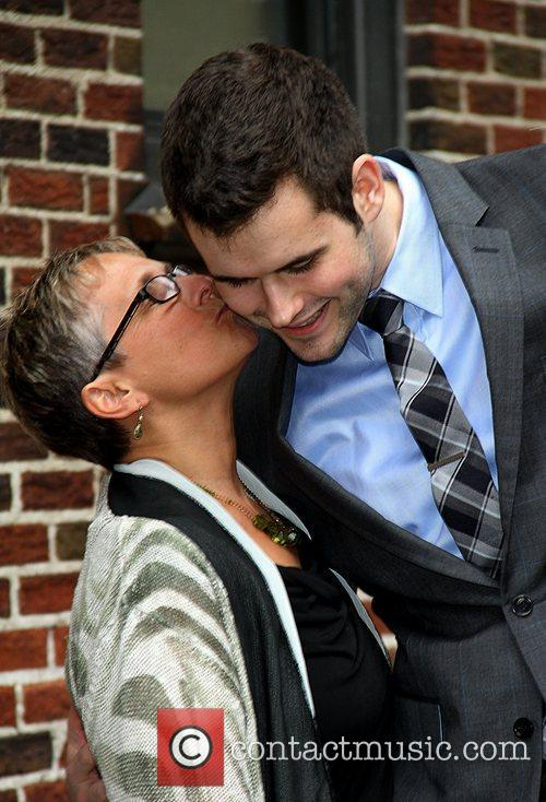 Zach Wahls receives a kiss from his mom...