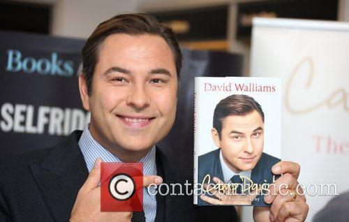 Signs copies of his autobiography 'Camp David' at...