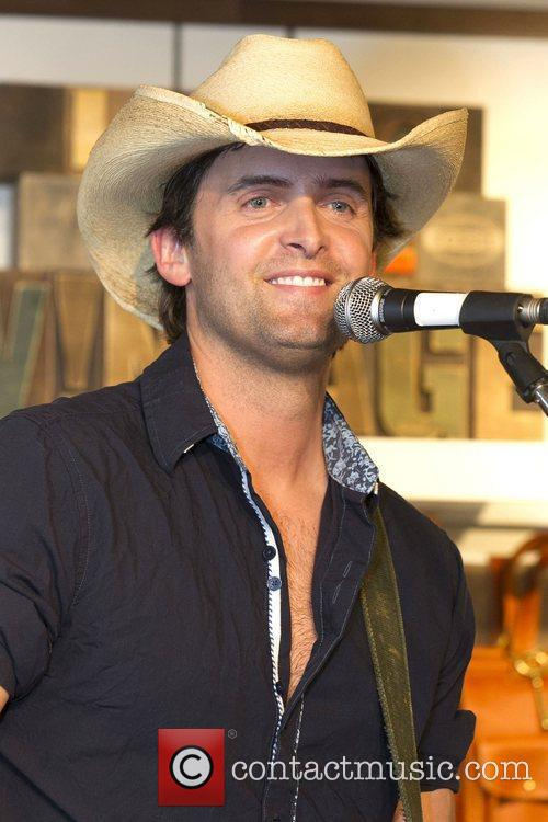 Performs an acoustic set at Fossil Canada Head...