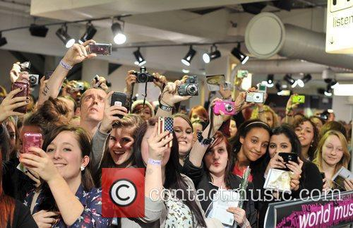 Atmosphere Demi Lovato signs copies of her new...