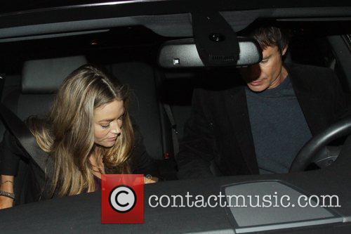 Denise Richards and a friend depart Madeo restaurant...
