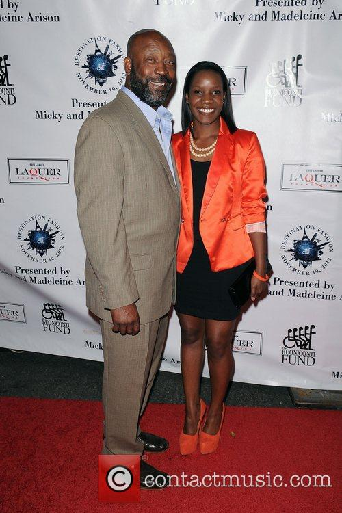 Tony Nathan and guest  attends  Destination...