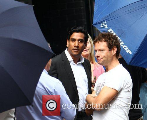 Naveen Andrews takes a break from filming on...