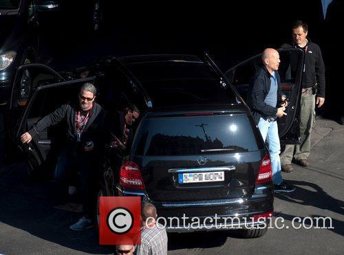 Bruce Willis gets out of a car on...