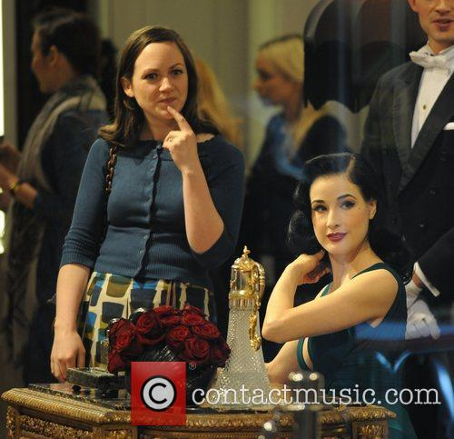Dita Von Teese  signs autographs during her...