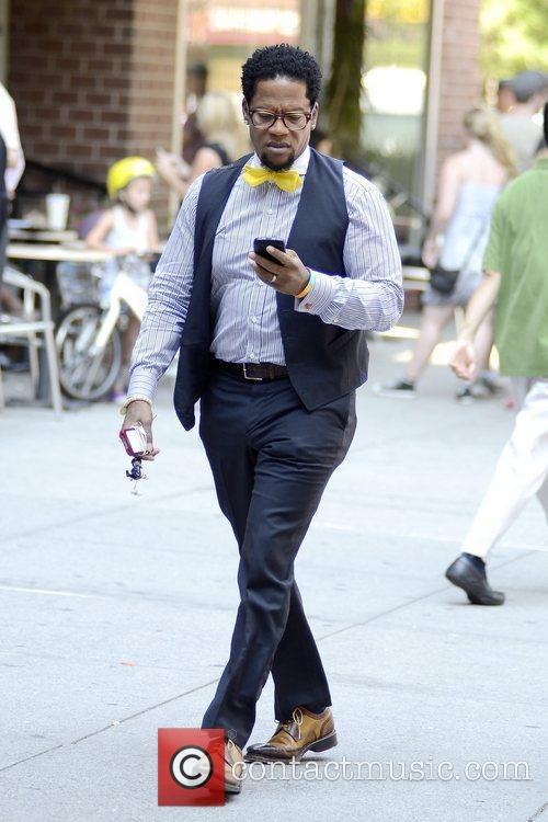 Seen on his cell phone taking a stroll...