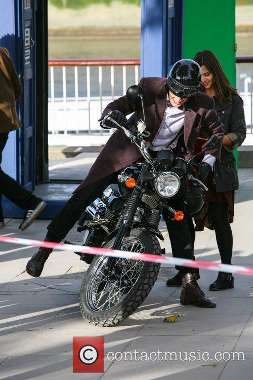 Matt Smith falls from a motorcycle as he...