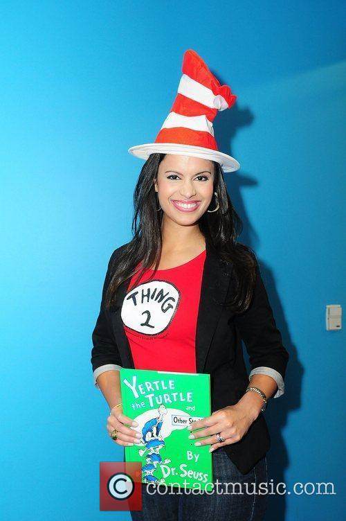 Anchor Roxanne Vargas reads a story to children...