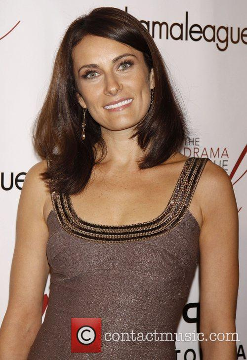 Laura Benanti wearing Carmen Marc Valvo  The...